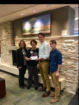 Temple Christian High School's student government presents check for Sherry Halker Fund